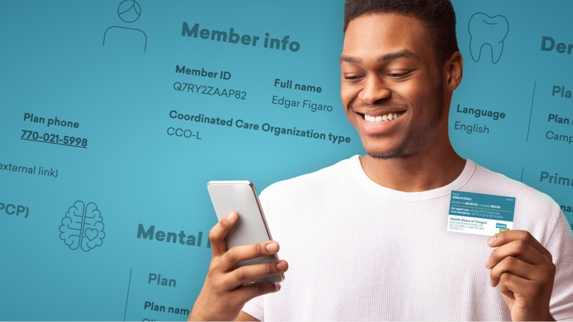 A smiling man holding his Health Share of Oregon member ID card in one hand and his smartphone in the other.
